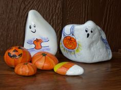 Halloween ghosts, pumpkins and candy painted rocks.