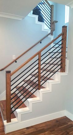Modern Staircase Design Ideas - Surf pictures of modern stairs and find design and layout ideas to motivate your own modern staircase remodel, including distinct railings and storage space . Steel Stair Railing, Modern Stair Railing, Stair Railing Design, Modern Stairs, Rebar Railing, Modern Basement, Metal Handrails For Stairs, Wood Handrail, Stair Spindles