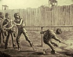 """The deadline that kept prisoners back from the walls of the stockade was marked by a simple fence. Prisoners who crossed the line were shot by sentries who sat in """"pigeon roosts"""" located every 90 feet along the wall. The man in this image was shot reaching under the fence as he tried to obtain fresher water than was available downstream. (Andersonville National Historic Site)"""