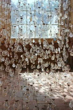 Ephemeral Rays: A Spectacular Installation Featuring Hundreds of Burnt Out Light Bulbs