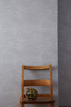 * Roll Size: 10.05m x 52cm roll (395″ x 20.47″)     * Repeat: Repeat 42cm (16.5″)     * Material: 100% renewably sourced FSC certified paper  Seascape wallpaper in Dusk is a white line drawing on a moody grey  background inspired by the rolling waves of a tempestuous sea designed to  flow across your walls.  The wallpapers and non-woven substrates are all sourced from sustainably  managed forests and are printed at one of the few remaining, traditional,  wallpaper printers in England, usi...