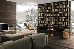 So much incredible-ness in this picture! The kitchen is also absolutely cool but seriously, who would not want to live their whole life reading books in front of that fireplace, especially on those snowy days.