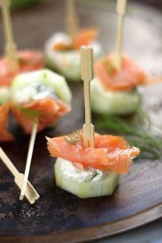 "2 English Cucumbers, peeled and cut into 1"" rounds 1 pound smoked salmon, cut into bite sized pieces (1) 8 ounce package cream cheese, softened 3 tablespoons fresh dill, chopped 1 tablespoon Horseradish (more or less to taste) 1 tablespoon heavy cream, optional Toothpicks or tiny party forks"
