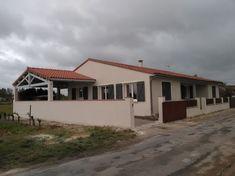 Rénovation de façade d'une maison et murets extérieurs. Réparation de micro-fissures existantes et peinture de façade.