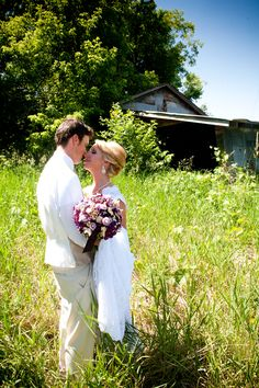 i love the field and old barn background! #WeddingPhotographer photo by Kim