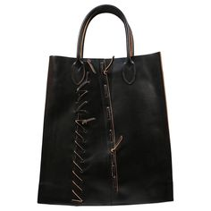 COMME DES GARCONS black leather bag with hand woven saddle stitching   From a collection of rare vintage tote bags at https://www.1stdibs.com/fashion/handbags-purses-bags/tote-bags/