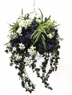 Handmade artificial floral and greenery hanging basket available in various colors and sizes. This hanging basket is handmade and therefore can be customized to your taste
