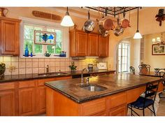 This #kitchen has breathtaking views and the decor flows nicely.