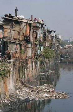 This is a picture of the Dharavi Slum in Mumbai. Dharavi is one of the largest slums in the world. There is so much pollution in the water and on land that people are living on top of the houses. Genius Loci, Slums, Varanasi, Dalai Lama, India Travel, Incredible India, Abandoned Places, Architecture, Mumbai