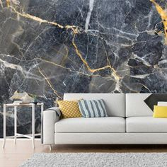 Stunning grey marble effect wall mural with hints of gold. Perfect for creating a feature wall in your living room! Add some luxury this season with a marble mural. Shop this and more at Wallsauce.com