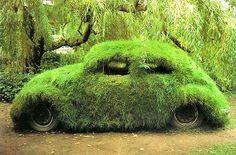 Danish artist Morten Flyverbom covered this VW Beetle in grass.