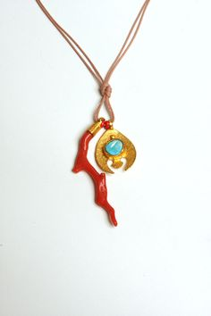 Handmade 22k gold plated Coral-Fish Amulet with raw Turquoise on Cord. $170.00, via Etsy.