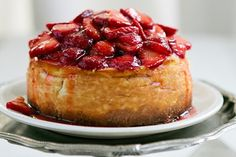 New York Style Cheesecake with Fresh Strawberry Sauce http://www.yummly.com/blog/2012/07/10-incredible-recipes-for-national-cheesecake-day/