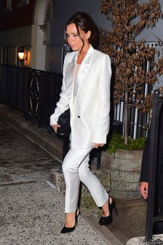 See 75 of Victoria Beckham's best street style looks: White silky suit