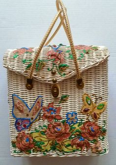 Midas of Miami wicker purse with butterflies and flowers.