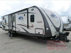 Step inside this spacious triple slide 2015 320BHDS Freedom Express Liberty Edition travel trailer featuring a rear bunkhouse. Upon entering the trailer you are immediately in a large spacious kitchen with island counter including a double kitchen sink.  Click to view additional photos, floorplan & today's best price at General RV Center!
