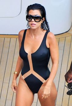 Kourtney Kardashian stuns in a black one-piece swimsuit on vacation in Italy — see more pics!