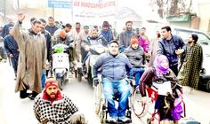 Disabled persons staging protest at Lal Chowk in Srinagar.   -Excelsior/Shakeel