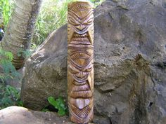 Here is a hand carved Tiki depicting Ku, Tiki of strength but also Kanaloa, Tiki of the ocean, fishing and abundance. This Tiki totem has also a double meaning, love and prosperity, which can be distinguished by the set of eyes going upward and downward.