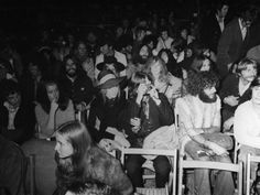 9-19 in 1969 - The Isle of Write Festaval (England)...played host to a long awaited performance by Bob Dylan. In the audience to enjoy his act are John & Yoko, Pattie and George with Maureen and Ringo...Mo has the large hat on in front part of the photo - look back and see a black hat Pattie is under with George next to her while John and Yoko are mid section of the photo.