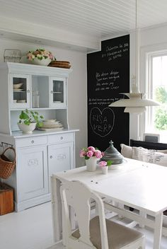 simple white kitchen with chalkboard wall