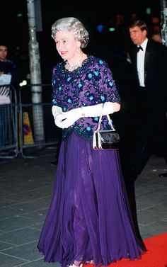 The Queen wearing a dress by John Anderson while arriving at the Dominion Theatre for The Royal Variety Performance. 1993