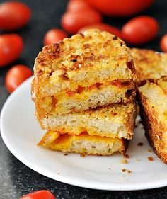 Panko Crusted Grilled Cheese & Tomato Sandwich    8 slices of stale french loaf (4 slices of normal bread loaf)  1 cup grated cheese (I've used red cheddar)  1 cup panko breadcrumbs  1 egg  1 tbsp milk  4 grape tomatoes, thinly sliced  Salt & pepper