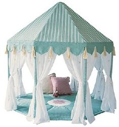 Cute, I'd probably make it look more Moroccan with rich colors and lots of pillows and throws. Maybe a little different top. Would be cute in their playroom.