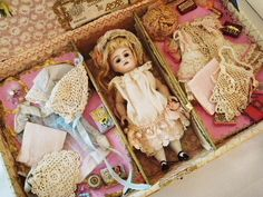 Antique doll and wardrobe