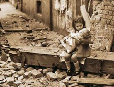 Girl with doll, after Liverpool bombing, my grandma was about this age at the time....she remembers it all
