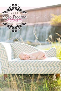 Newborn baby girl on teal and white chevron chaise in front of waterfall. Outdoor newborn session. Andie Freeman Photography.  www.TheAthensNewbornPhotographer.com