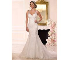 This stunning Stella York fishtail wedding dress oozes sophistication and class in every way. The beautiful sparkly straps and bodice detail are insanely pretty and feminine. We would love to see this style worn alongside some sparkly bridesmaid dresses for an all-round glamorous wedding look.
