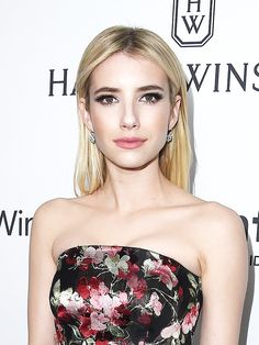 Emma Roberts looks gorgeous with sleek hair, smoky eyes, and porcelain skin