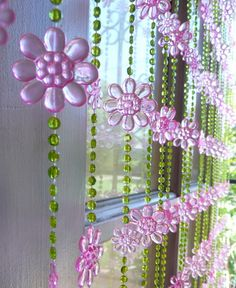 This beaded curtain has pink daisy flower beads with small green beads in between them...Beaded strands are easily removed from the rod if you so desire...Size: