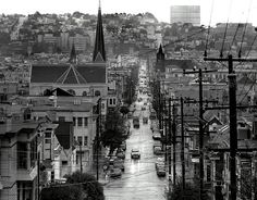 Looking east down 23rd St. in San Francisco's Mission district. Potrero Hill in the background.