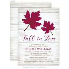 Rustic fall bridal shower invitations with burgundy and brown leaves on a wood background.