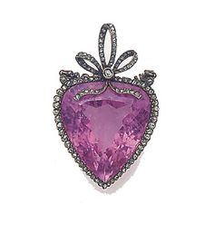 A Belle Epoque pink tourmaline and rose-cut diamond pendant, the single faceted heart-shaped pink tourmaline drop with rose-cut diamond border and bow cluster surmount, suspended from a rose-cut diamond twin line to a pendant loop, in fitted case stamped LACLOCHE FRERES, 15 RUE DE LA PAIX, PARIS.