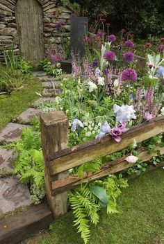 Cottage like with nice mix of more cultivated varieties mixed with ferns, bulbs, etc. Something like this along front of house and/or around to SE and S. CS