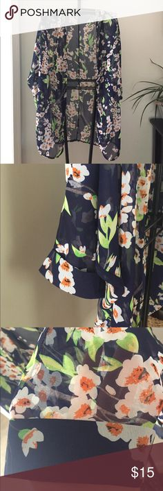 Flowy Chiffon Kimono Cardigan Lightweight, breezy floral kimono cardigan blouse. The background color is navy blue and the flowers are white with a coralish color. This is easy to throw on and make an outfit complete! Never worn. Tops