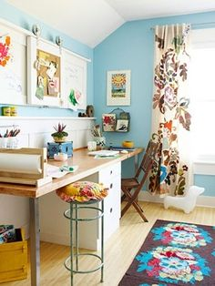 craftroom - I'm in-love with this little space: the rug, the curtains, pillow on the stool!
