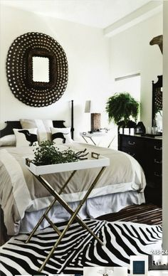 Black and white bedroom. Def like darker furnishings but like the white, taupe and black together