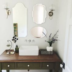 3 mirrors, 2 #schoolhouseelectric #orbitsconces, 1 pretty powder room (via @pearlyo) / Shop our feed - link in profile