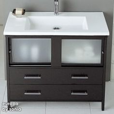 A contemporary shape with a big sink. Could store cleaning brush and plunger horizontally in a container in the bid drawer.