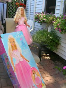 life size barbie! I wanted one of these but we were to poor..lol I only wanted the dress and shoes... forget the creepy doll
