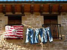 Beautiful Barcelona one of my favorite cities filled with some of my favorite people. They have such fabulous britches and they never mind showing them off.  #Barcelona #spain #españa #español #bluejeans #flags #laundry #airdry #clothesline #clothes #fashion #europe #eu #streetlife #steetphotography #streetphoto #photobyjaina