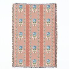 A vintage coral polka dot wallpaper pattern throw blanket with old fashioned feminine blue roses tied with with pretty cream colored bows.