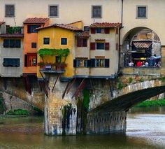 "The Ponte Vecchio (""Old Bridge"") is a Medieval stone closed-spandrel segmental arch bridge over the Arno River, in Florence, Italy, noted for still having shops built along it, as was once common. ..."