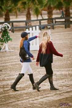 """The ultimate blonde """"California Girl"""" Ashlee Bond walks the course in a chunky sweater. 