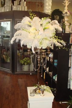 @ Michelle.. Now I love ostrich feathers when mixed with flowers like this :)