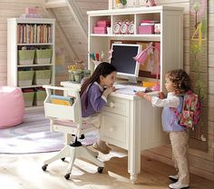 Telling secrets or talking about homework at the Thomas Desk & Hutch...